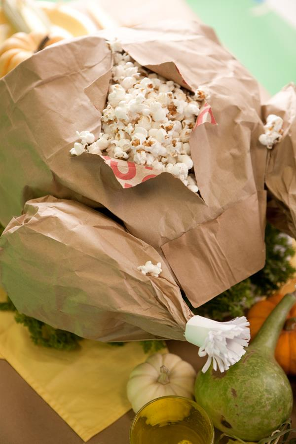 Make a paper bag turkey full of popcorn for a funny Thanksgiving treat