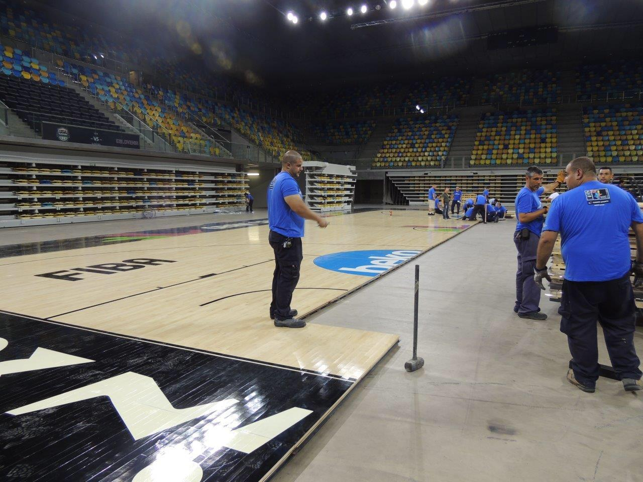 Arena team learning how to install a Connor Sports Basketball Court in record time