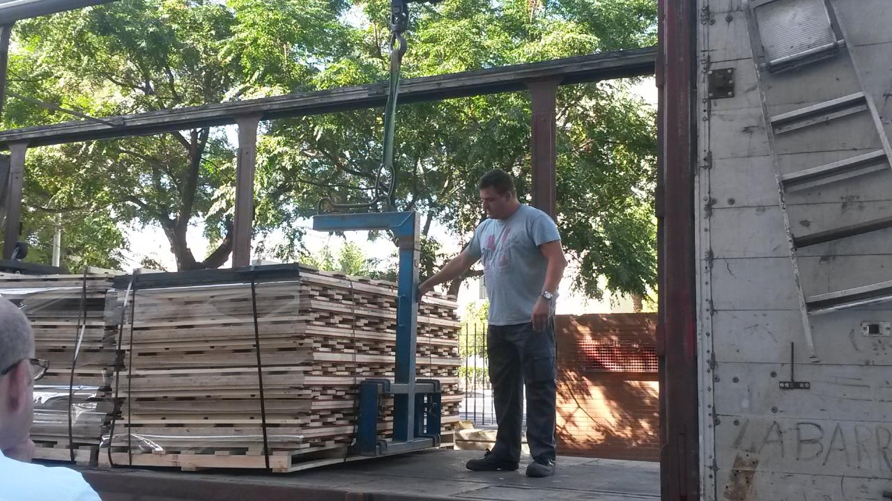 Connor Sports QuickLock pallets getting unloaded in Spain