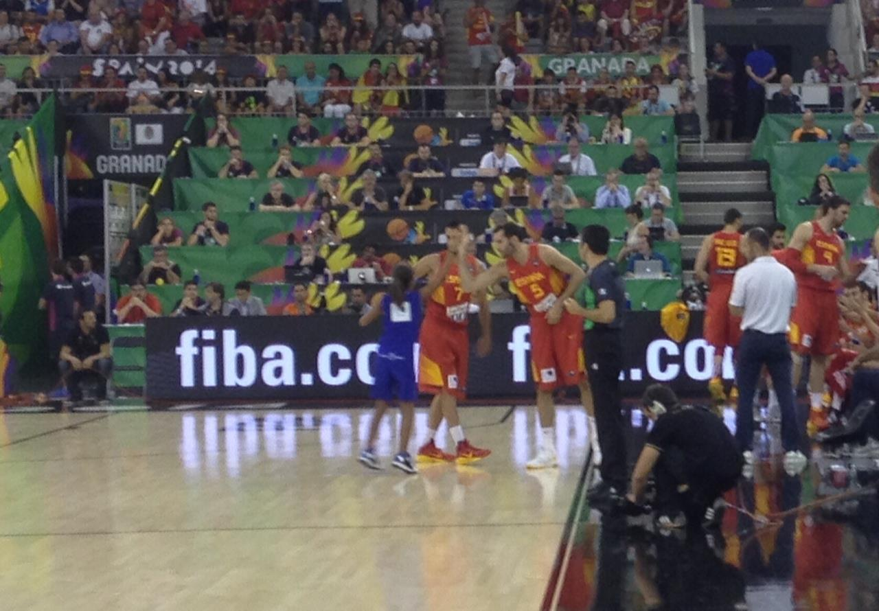 Spain high fiving the game ball girl
