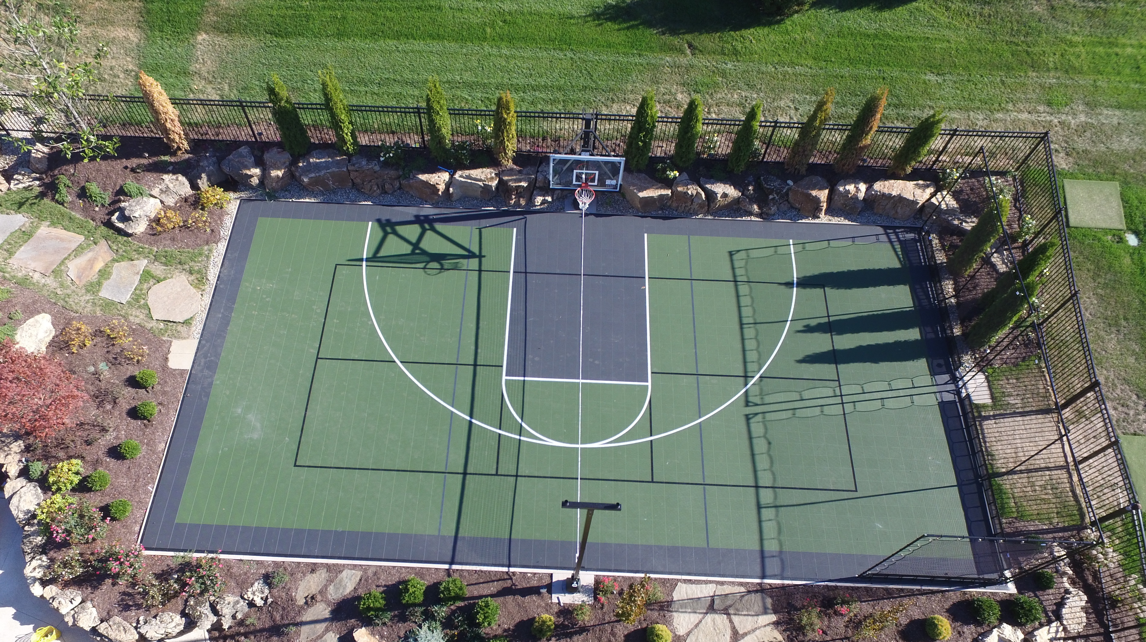 Why choose a sport court backyard game court instead of a for Backyard sport court