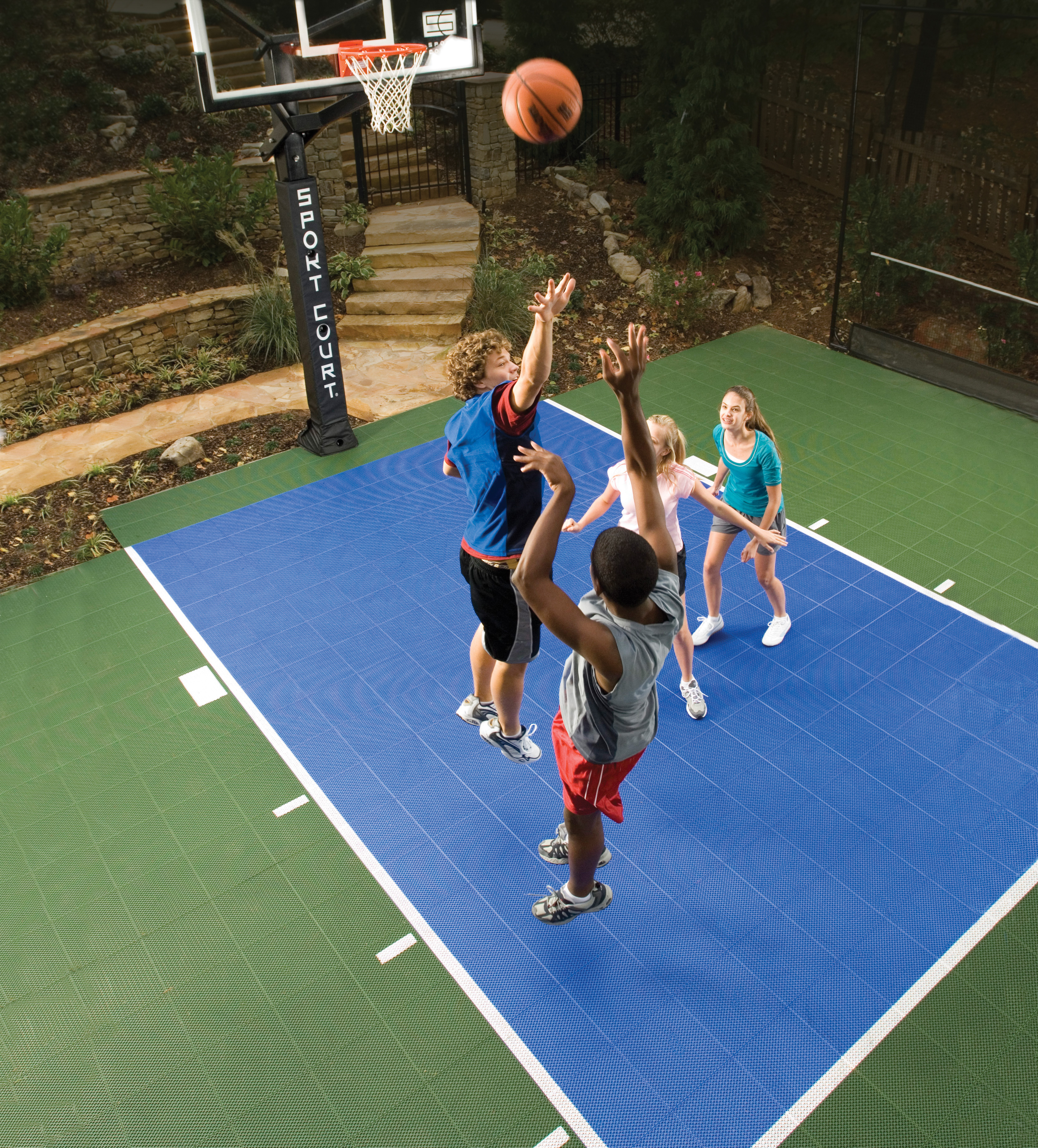 Go green with a sport court backyard basketball court Cost to build basketball court