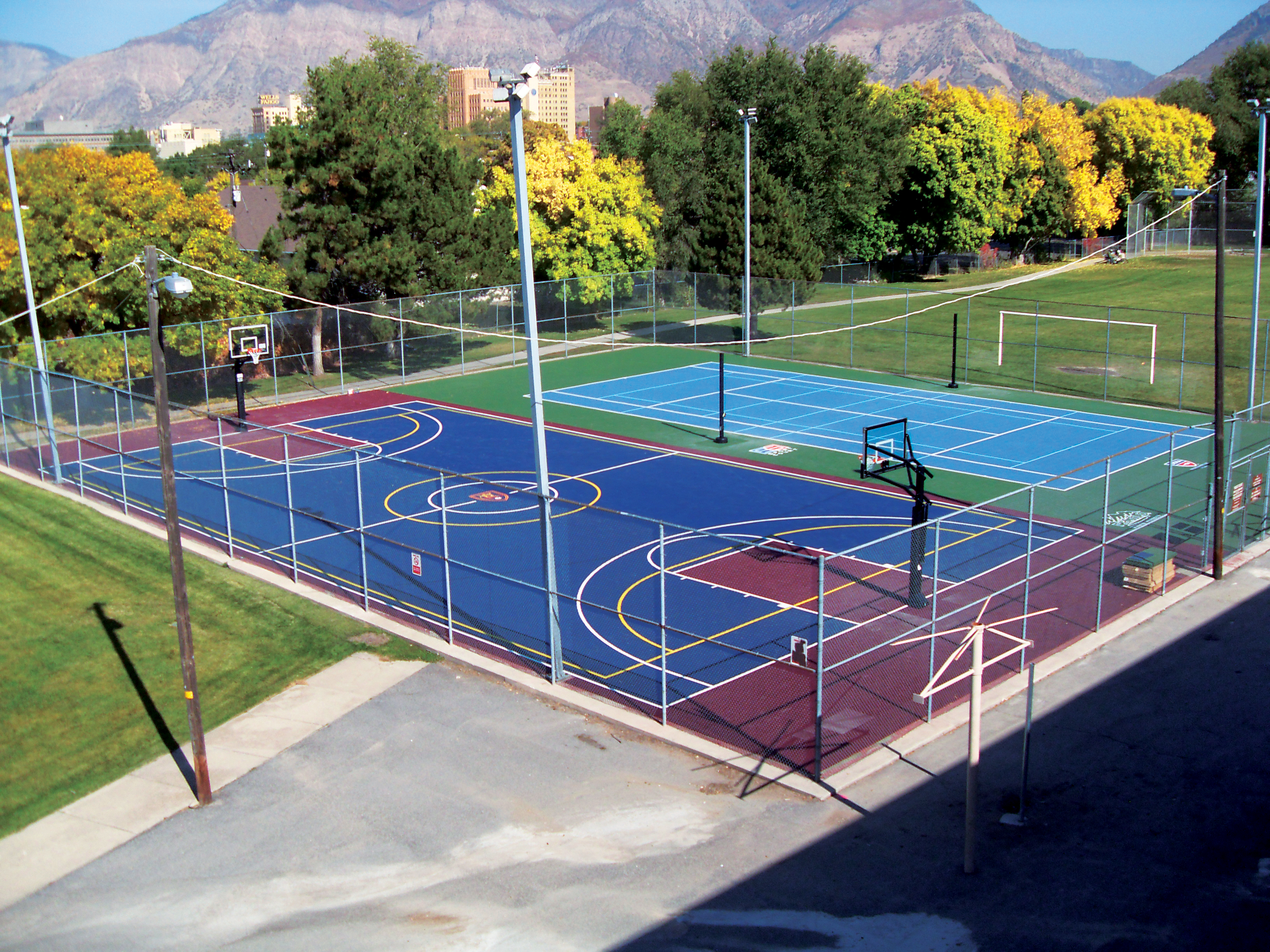 Playground games for your sport court backyard court for Backyard sport court