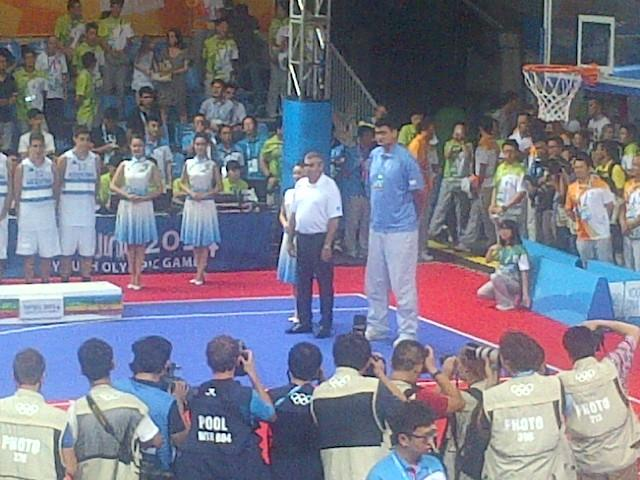 IOC President Thomas Bach presents medals on the Sport Court basketball court at the Youth Olympic Games