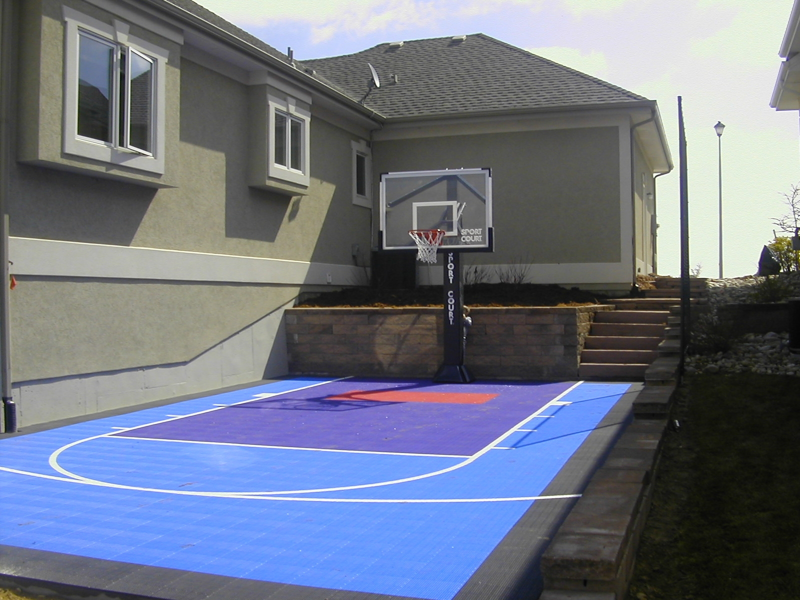 small backyard not a problem with sport court sport court. Black Bedroom Furniture Sets. Home Design Ideas