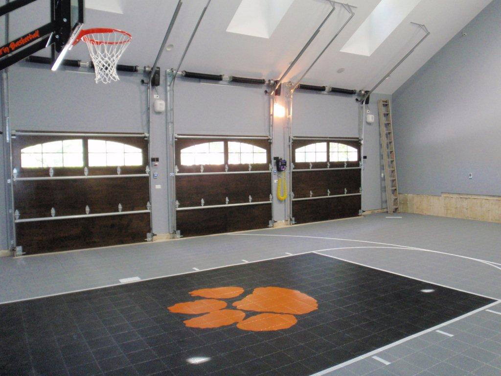 Fitting a home basketball court in your backyard sport court for Indoor basketball court flooring cost