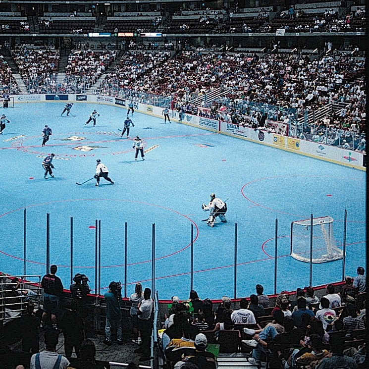 roller hockey game played on sport court athletic floor