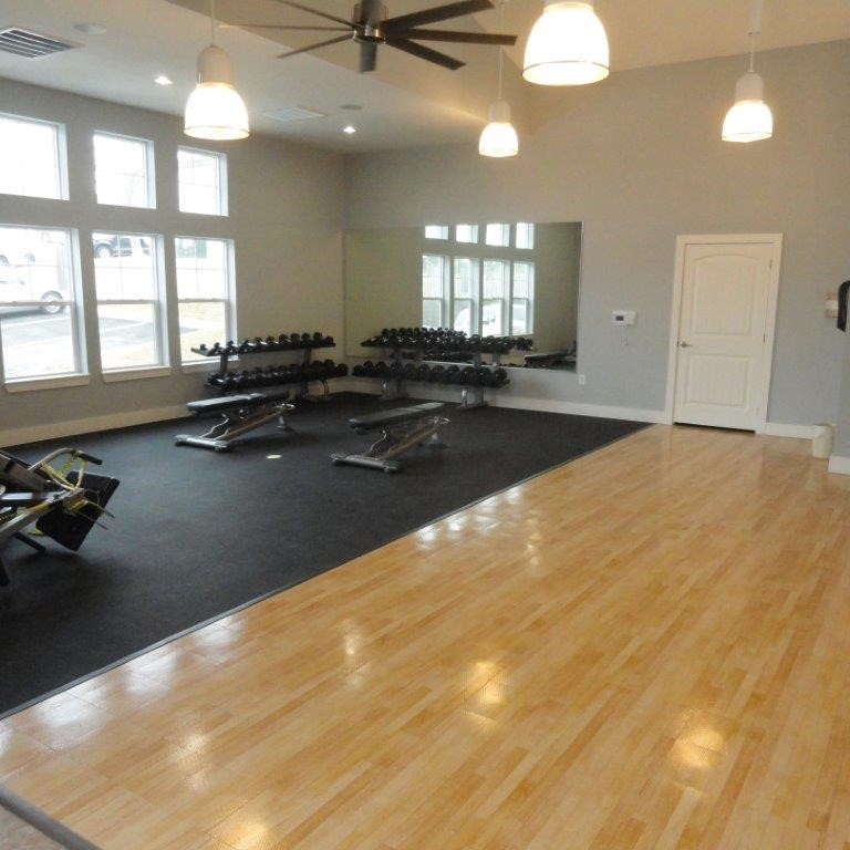 family indoor home gym and work out room on sport court surface