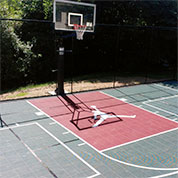outdoor backyard home basketball court with custom jumpman logo