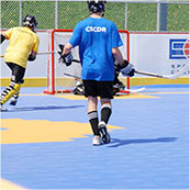 roller hockey on outdoor sport court surface
