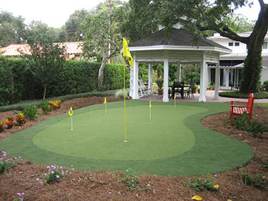 Backyard Putting Green and Synthetic Grass at Palm Beach, Florida Home