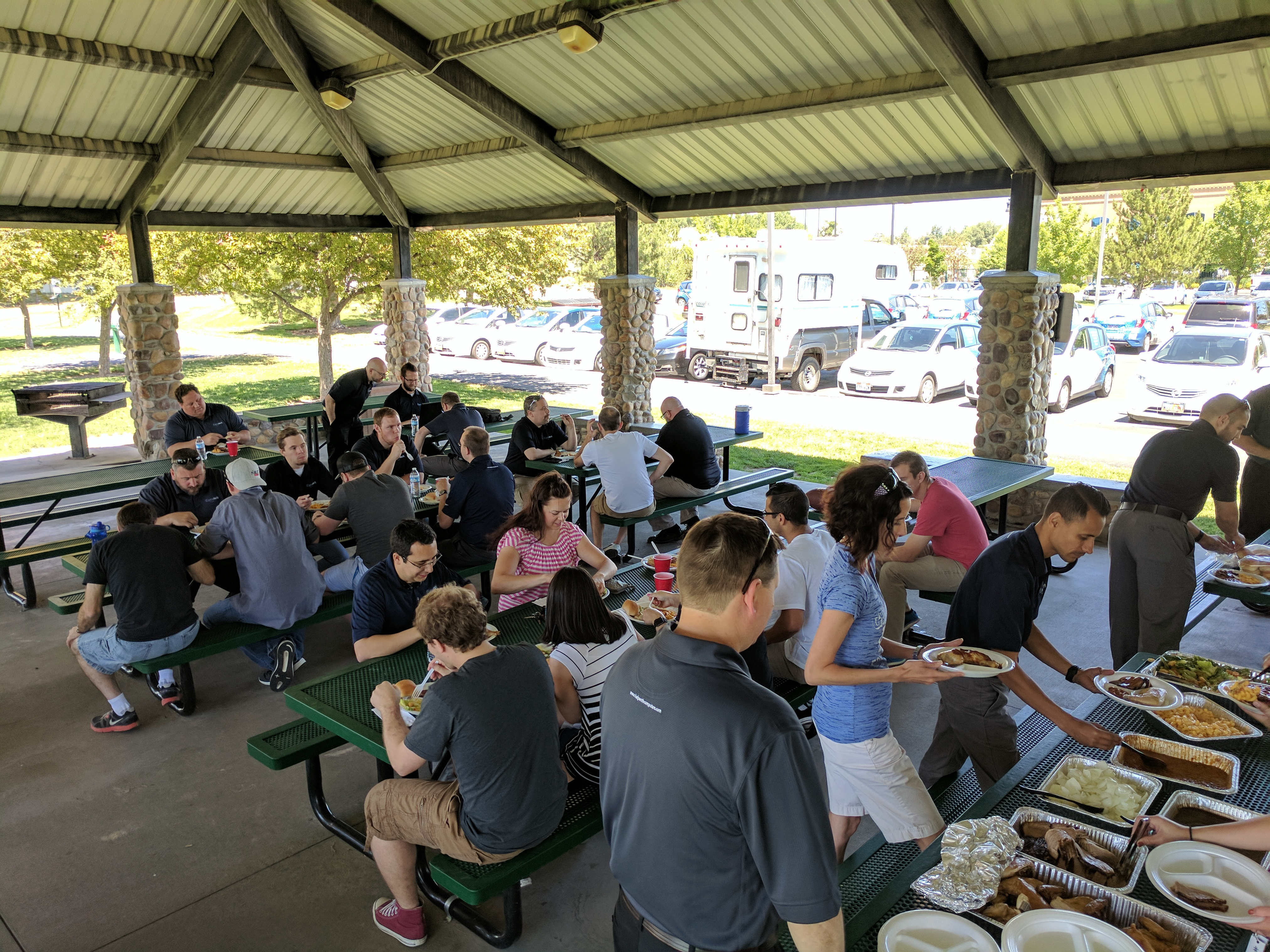 Executech employees enjoy spending time together at a company BBQs.
