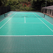 Backyard Tennis Court with Tennis Court Surface by Sport Court Central Florida & Palm Beach