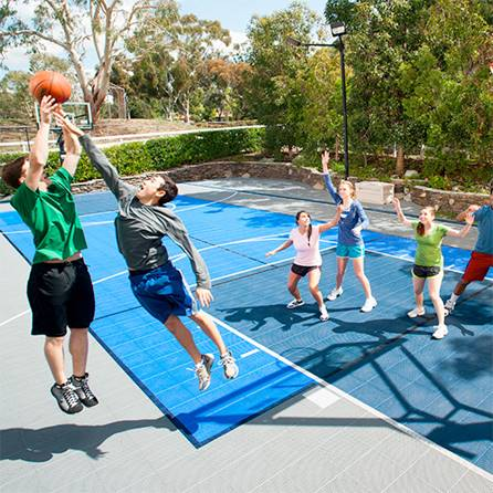 Family sport courts convenient backyard courts for Cost for basketball court