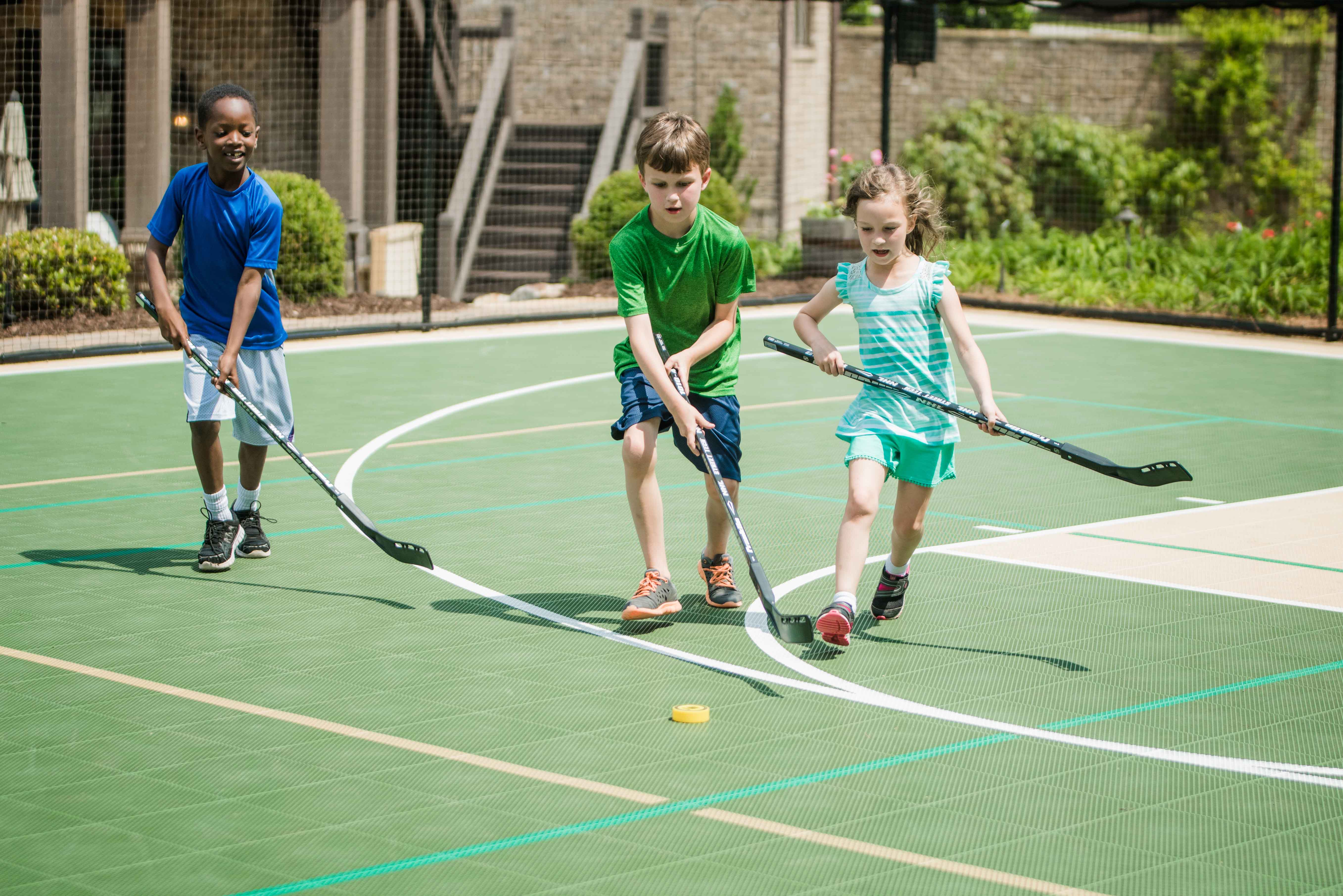 Kids Playing Hockey on Sport Court